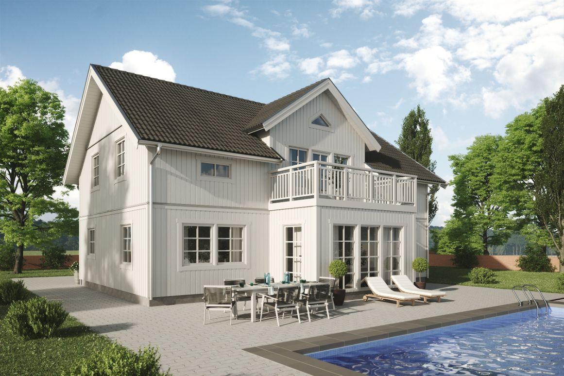 sädesärlan klassiskt vitt hus med grått tak